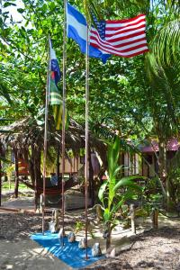 little-corn-island-nicaragua-beach-bungalow-eco-lodge-resort-hotel-flags
