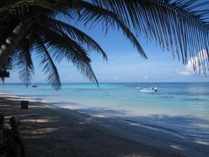 little-corn-island-beach-ocean-panga-boat